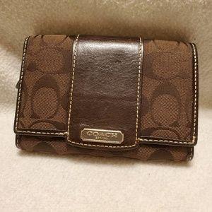 Coach brown wallet pink lining medium size